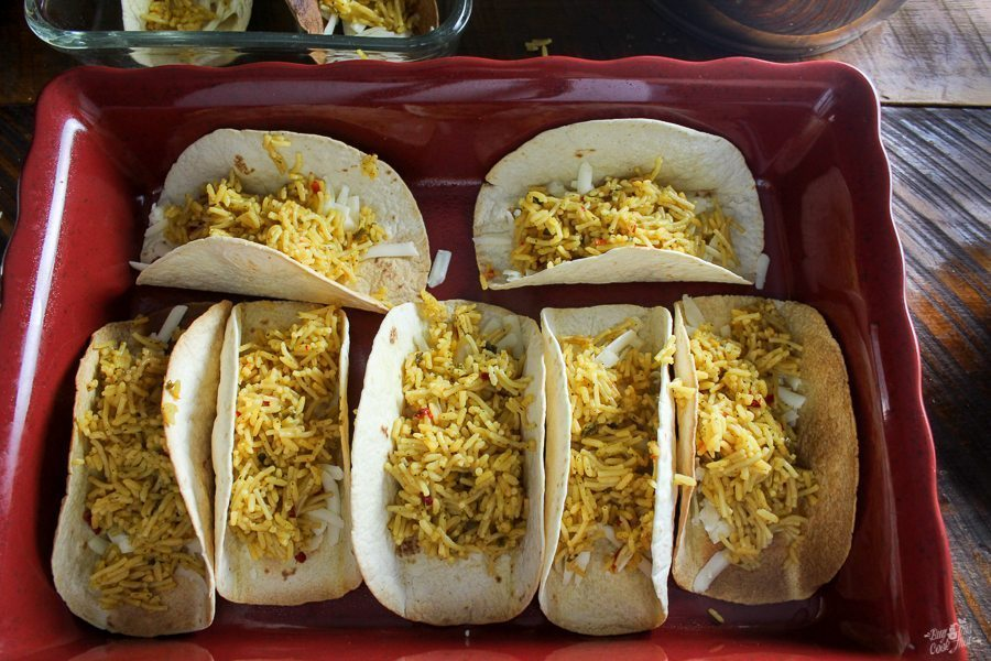 These are so warm yummy: full of beef, rice and cheese! And topped with more cheese. :) You will wonder why you have never made Cheesy Baked Tacos before.