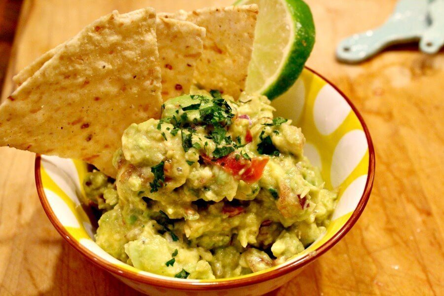 Want guacamole better than what you get in a restaurant? Fresh squeezed lime juice and chopped cilantro highlight avocados in this zesty & fresh guacamole.