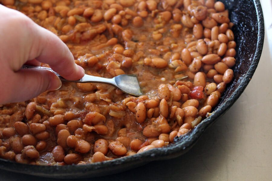 Easy, peasy, beans and cheesy! Why buy them when you can make them 10 times better yourself? Get our recipe for Homemade Refried Beans here.