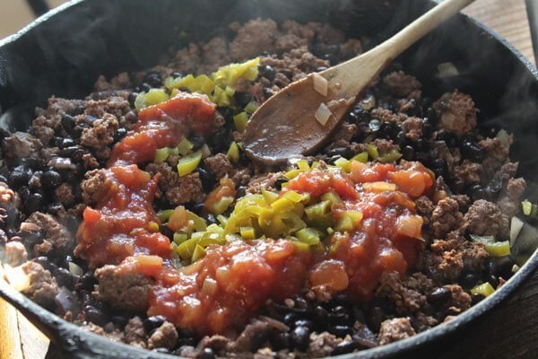 For our black enchilada recipe, we had ground beef on hand (thanks, Dad!), and we had some leftover black beans.
