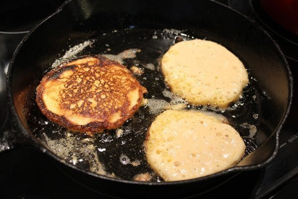 Fried Cornbread Cakes in a cast iron skillet