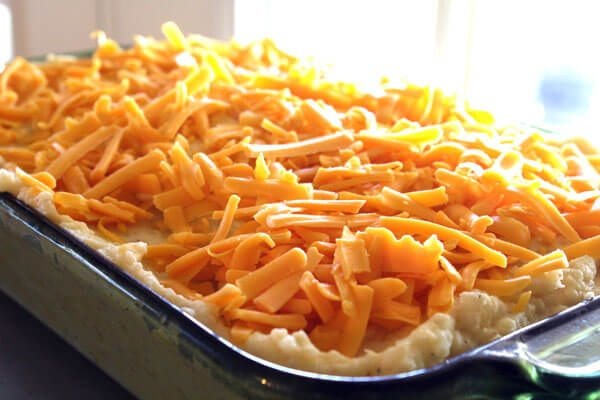 Say no to boring potatoes with Cheesy Mashed Potato Casserole. Load 'em up with cheddar cheese, sour cream and butter, and give your meal a special side.