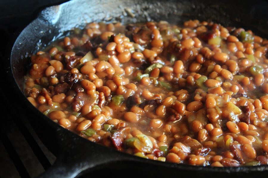 Tired of being stuck in the kitchen? Move the baked beans outside and throw them in the smoker. Classic summer dish with delicious, smoky sweet flavor.