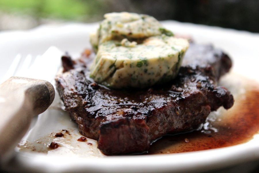 Garlic Herb Steak Butter is the perfect topping for your favorite grilled steak. Rich buttery flavor, with garlic and fresh parsley and cilantro.