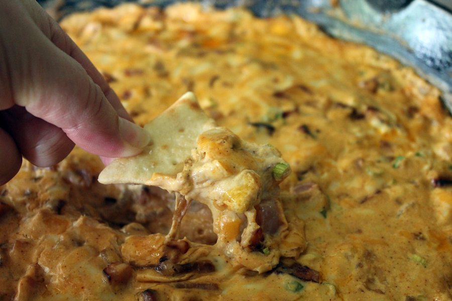 Hot Ham Dip, perfect for your next Arkansas tailgate and football gathering. Savory cheese, caramelized onions and perfect ham!