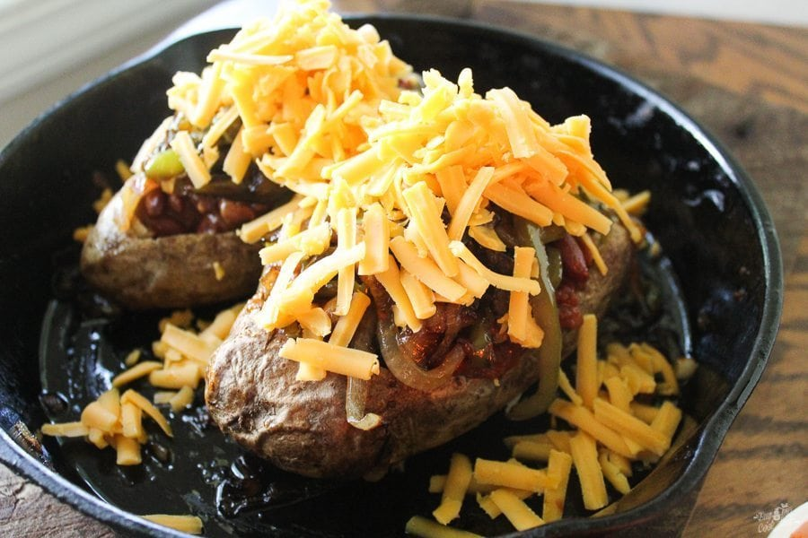 Why have a plain old baked potato when you can make Chili Potato Bowls? Fall is here, time for all of your favorite comfort foods. Cheesy and easy!