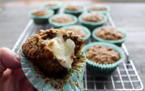 A fresh and warm Apple Oatmeal Muffin with melted butter.