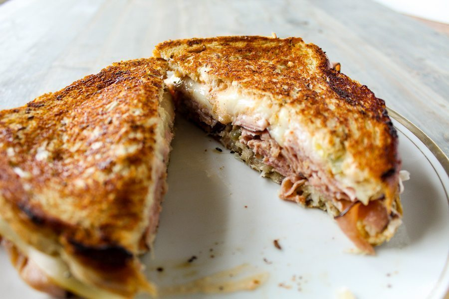 A Killer Ham Reuben Sandwich recipe. Layers of deli-sliced black forest ham on New York rye. With Muenster cheese, sauerkraut and Russian Horseradish Sauce. Money.