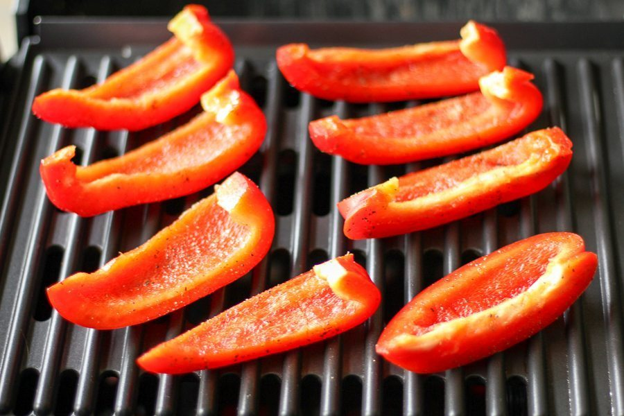 Red bell peppers on the grill