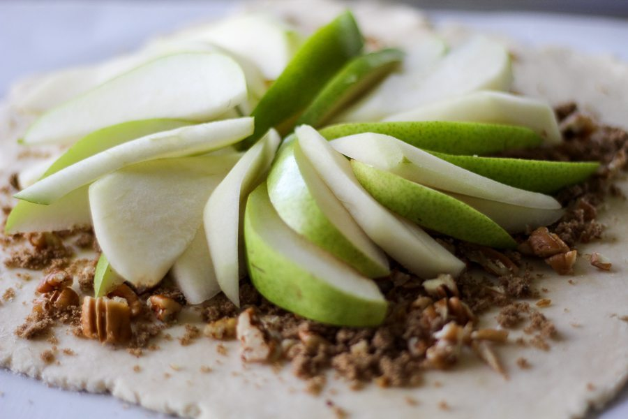 Fresh sliced pears on top of a galette crust