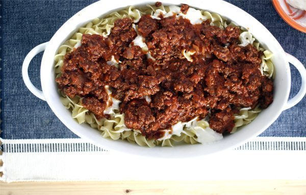 Beef and tomato sauce over hot noodles