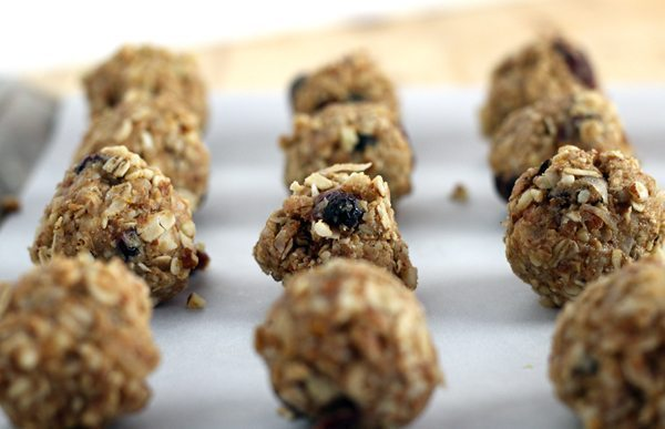 Almond Oatmeal No Bake Energy Bites on parchment paper