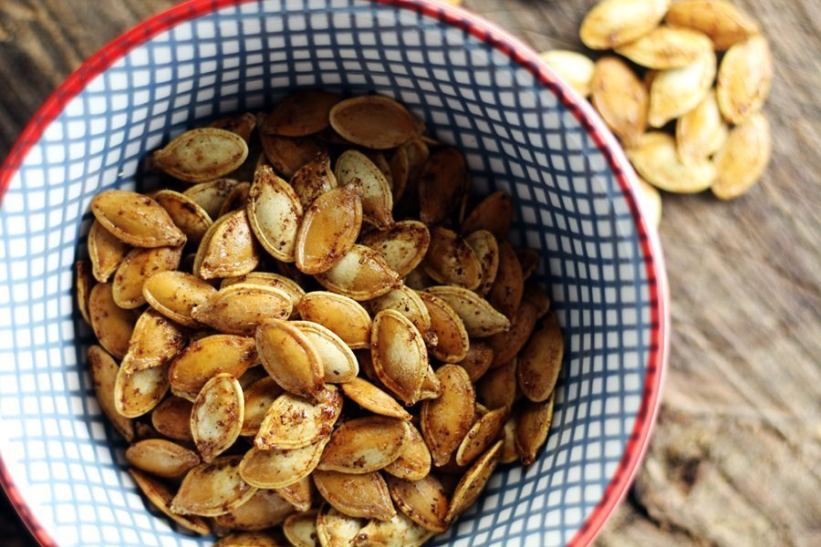 Toasted and spiced pumpkin seeds in a bowl