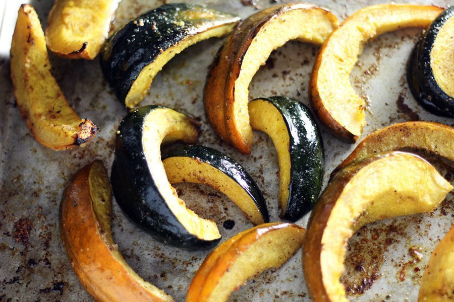 Acorn squash wedges roasted on a baking sheet