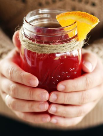 Wrap your hands around a warming mug of Spiced Cranberry Apple Cider this season.