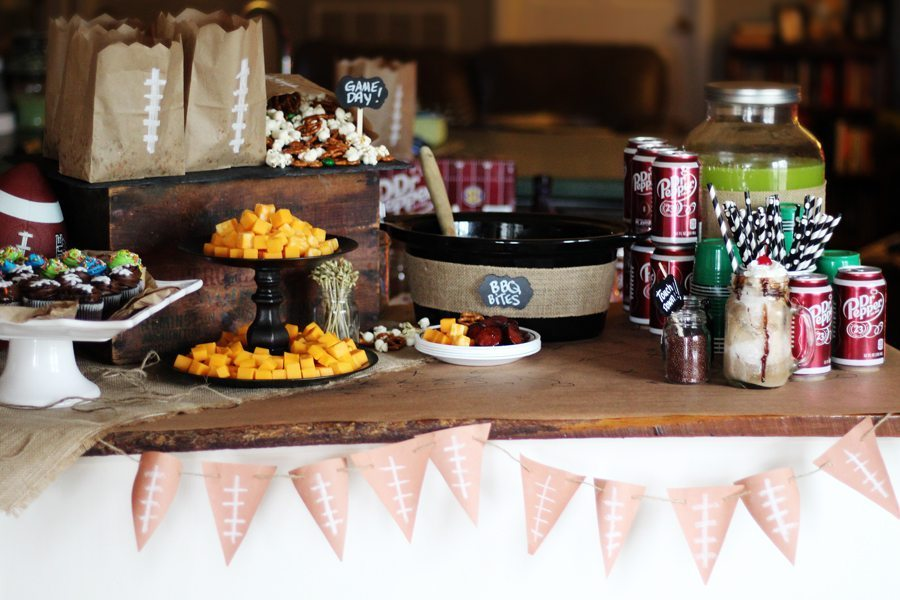 A table set up with gameday party snacks, drinks and more.