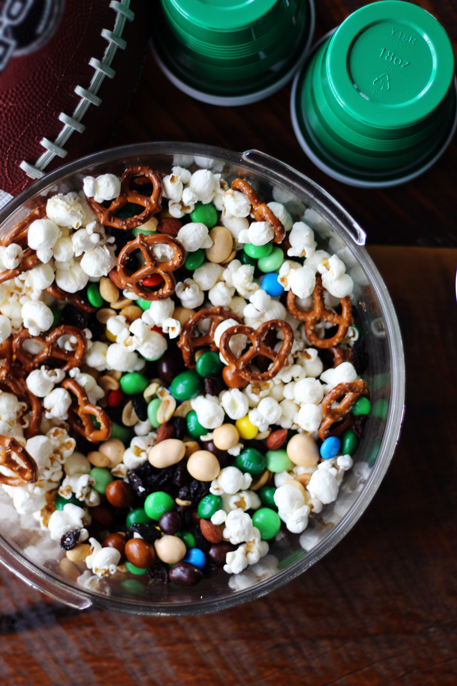 A snack mix of popcorn, chocolate candies, pretzels and more