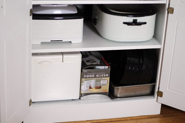 Storing appliances by frequency of use helped me keep my kitchen pantry organized.