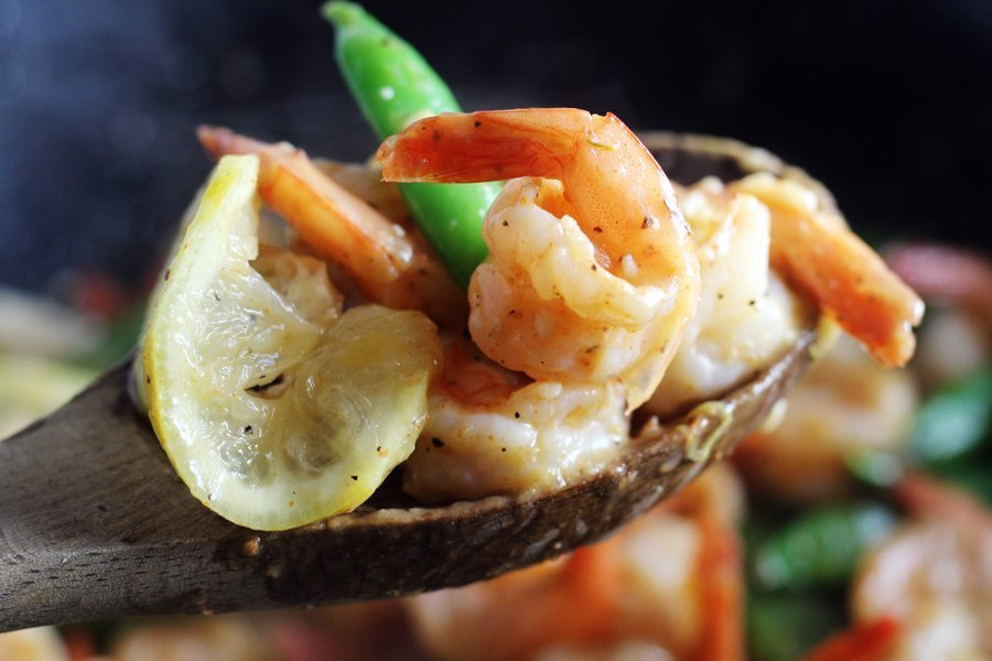 A wooden spoon with garlic lemon shrimp