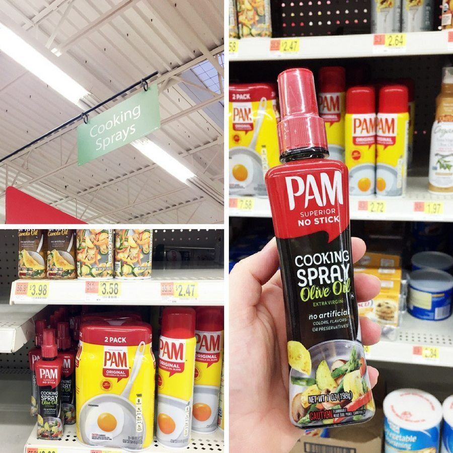 A bottle of PAM olive oil cooking spray next to the cooking spray shelf inside a Walmart store