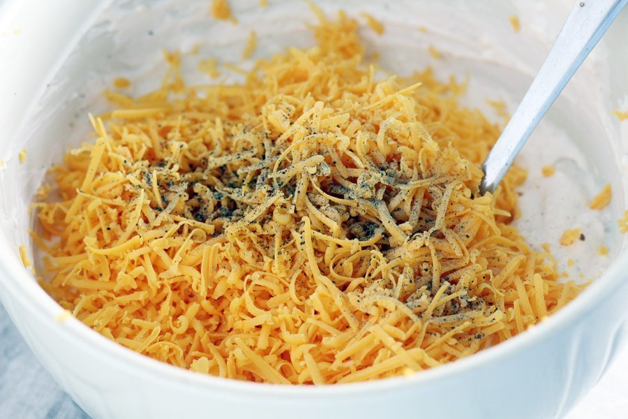 Shredded cheddar cheese in a bowl