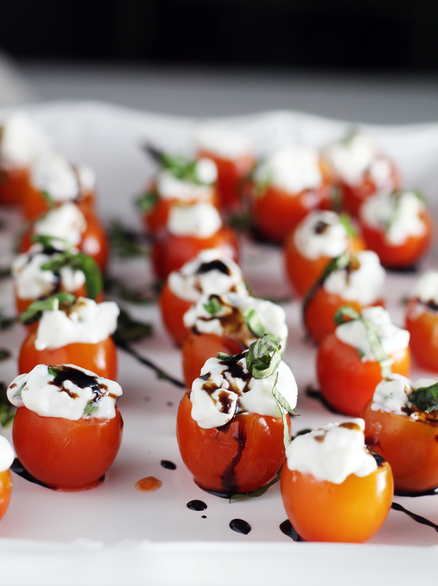 Serve the Tomato Basil Caprese Bites drizzled with homemade balsamic reduction and fresh chopped basil.