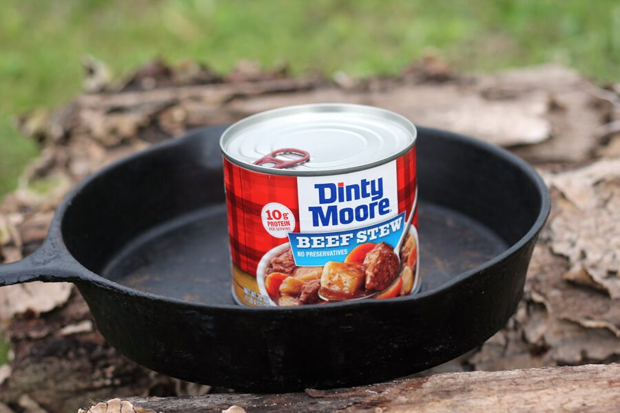 A skillet with a can of Dinty Moore Beef Stew
