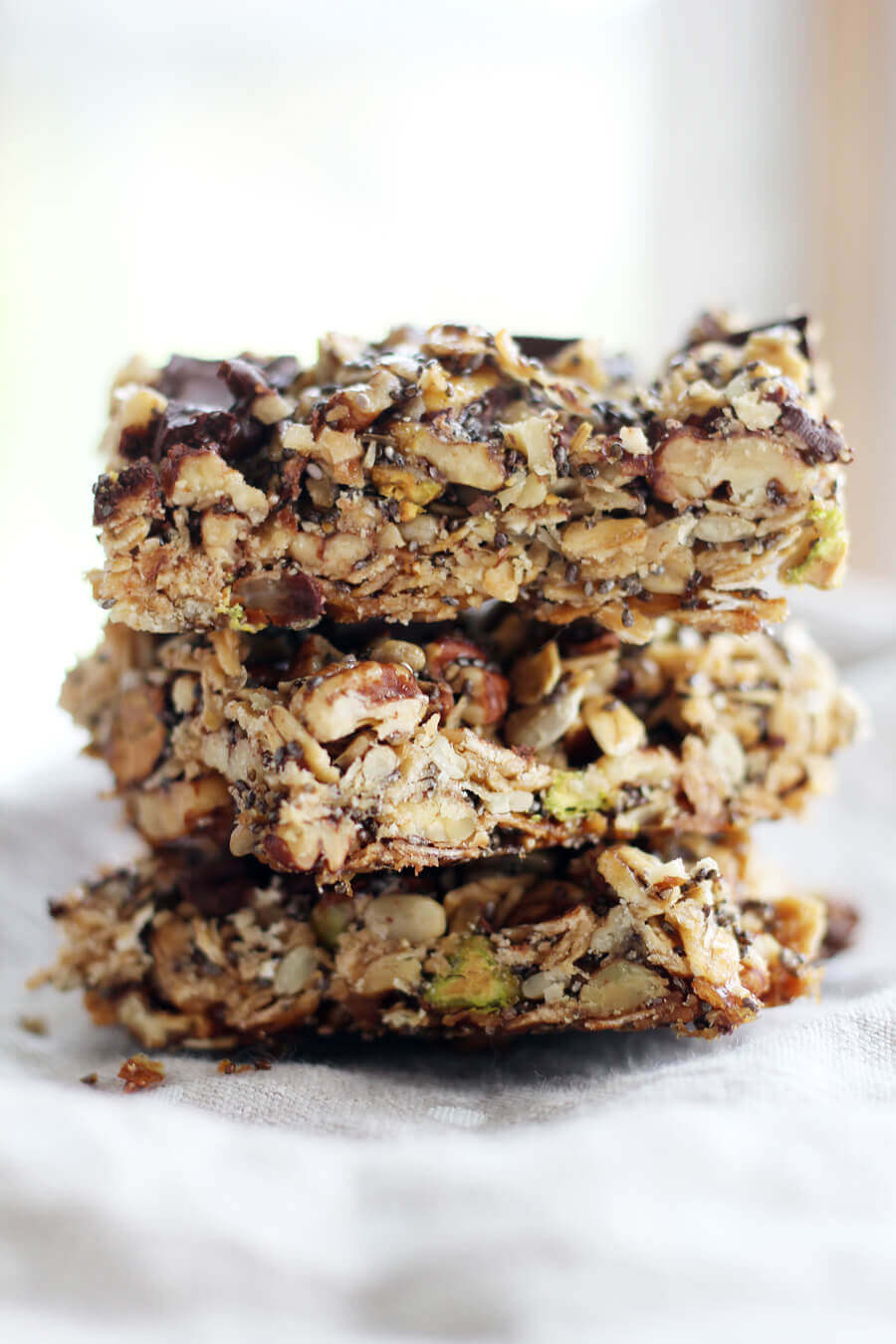 a stack of homemade pecan granola bars