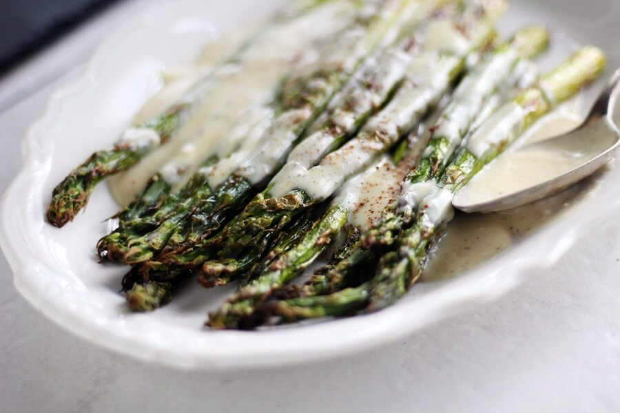 A close up finished shot of Roasted Asparagus with White Cheddar Sauce