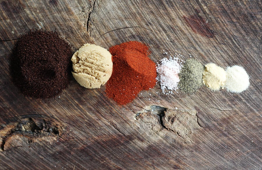 coffee, brown sugar, paprika and more spices on a wooden background