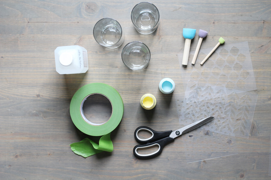 an overhead shot of supplies needed to make your own stenciled drinkware