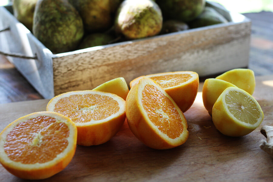 Fresh sliced oranges and lemons on a wooden board