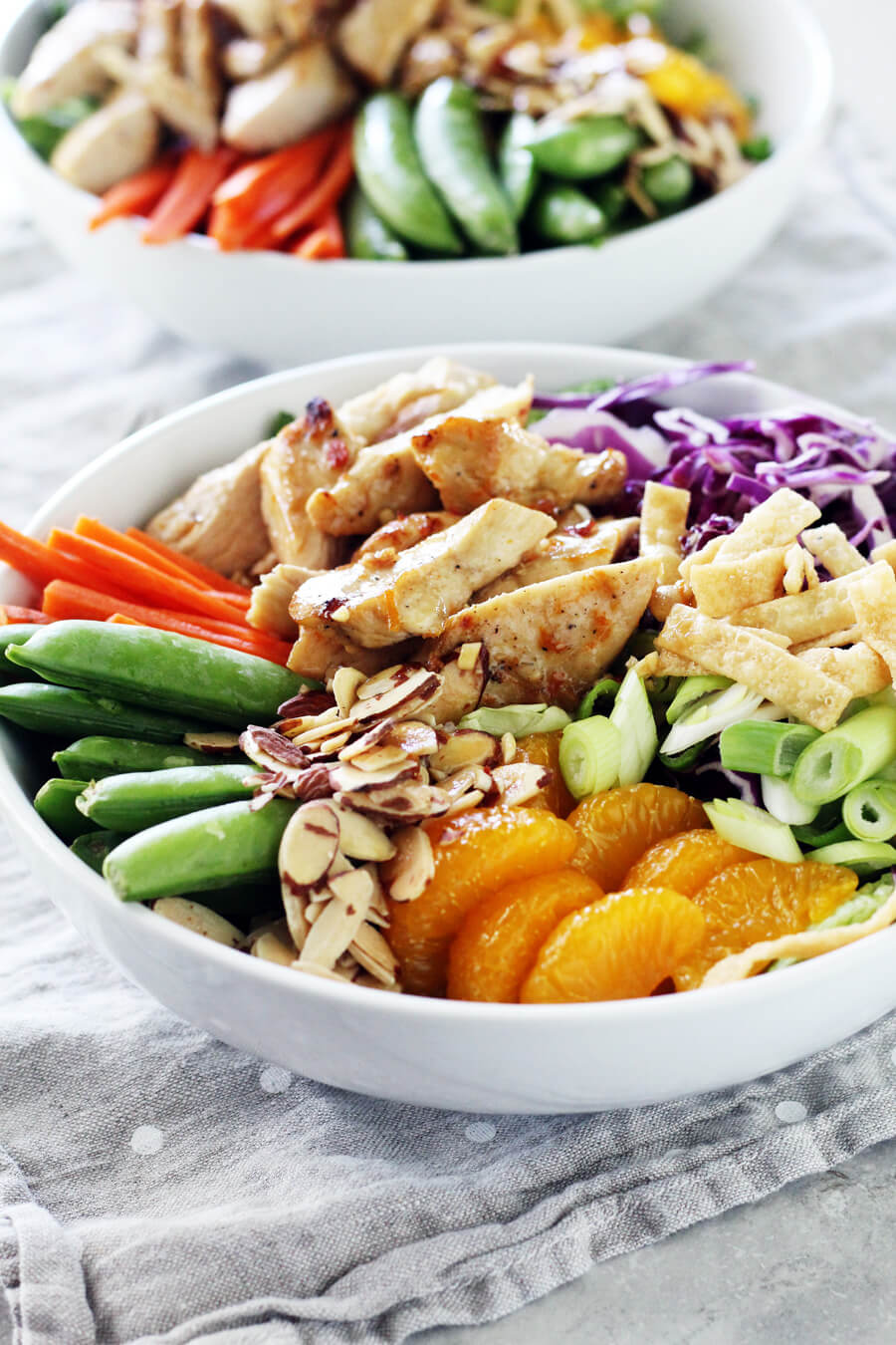 Mandarin Chinese Chicken Salad with fresh sugar snap peas, carrots, purple cabbage and marinated chicken.