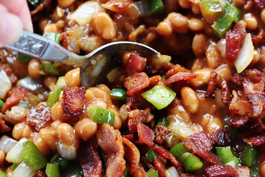 Bacon Lovers Baked Beans Recipe | Buy This Cook That - Sweet and savory baked beans with loads of smoky bacon, and topped with even more bacon. This is the baked bean recipe that everyone will be raving about!
