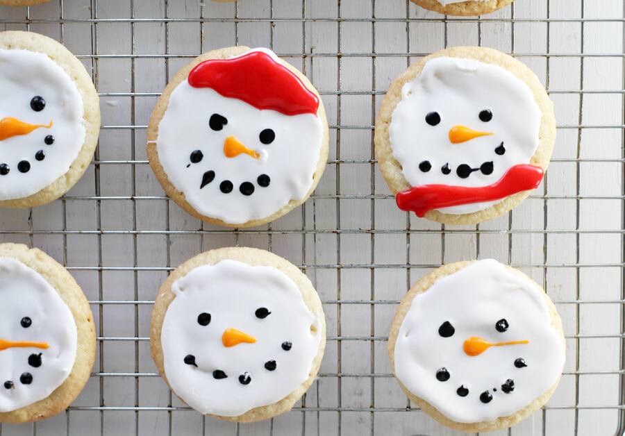 There are fun holiday recipes and there are also easy holiday recipes. This recipe for Snowman Christmas Cookies is BOTH. Cookies + holidays go hand in hand, and this is a delicious twist on a classic sugar cookie. So put on your happy faces and let's build snowman cookies. p.s. This cookie isn't just a pretty face. He's got a surprise inside!