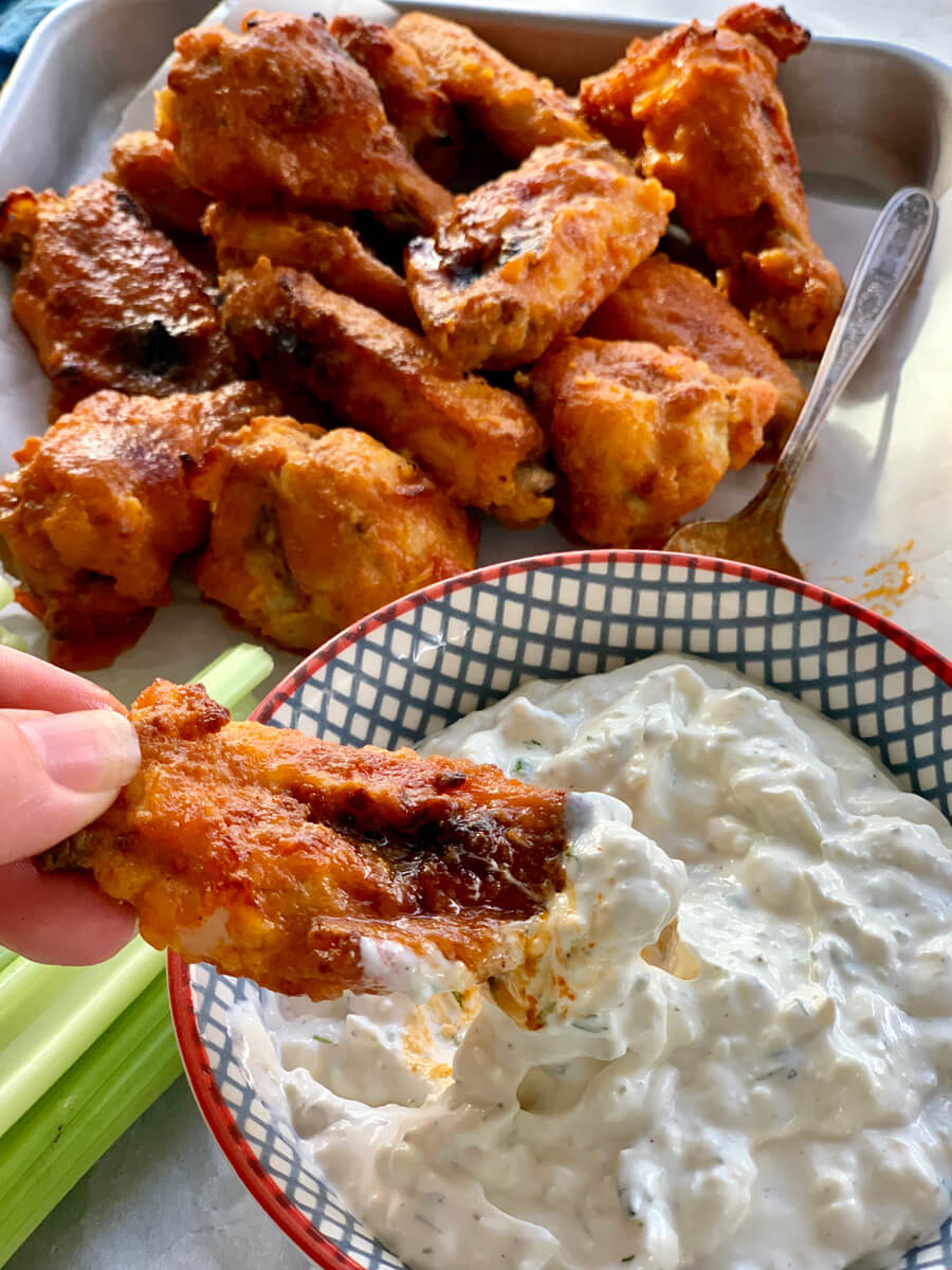 Satisfy those cravings with our recipe for Buffalo Wings. Tender chicken, cooked until crisp, and coated in a zingy hot sauce oozing with butter.