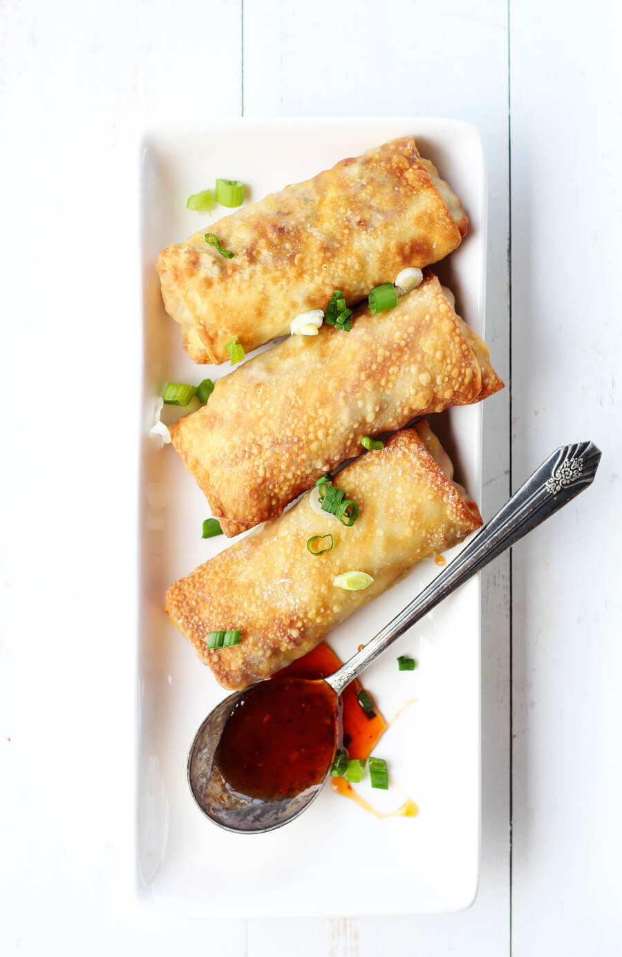 Learn how to make your own egg rolls at home...in an air fryer. This easy recipe is so delicious, with light and crispy crust and tender and savory on the inside.#eggrolls #airfryer