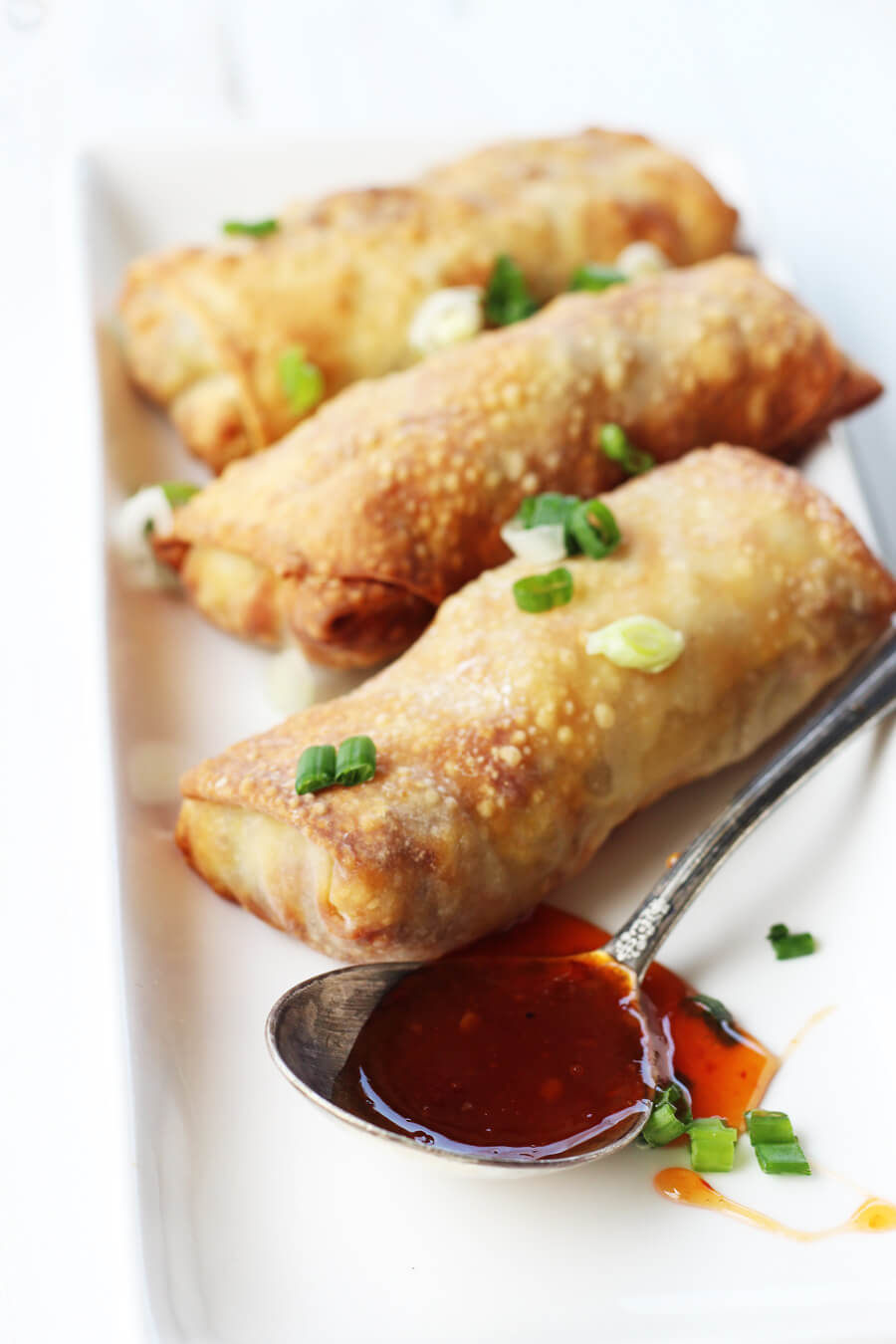 Crisp Asian-inspired egg rolls with savory pork and tender cabbage on the inside....made with our air fryer.#eggrolls #airfryer