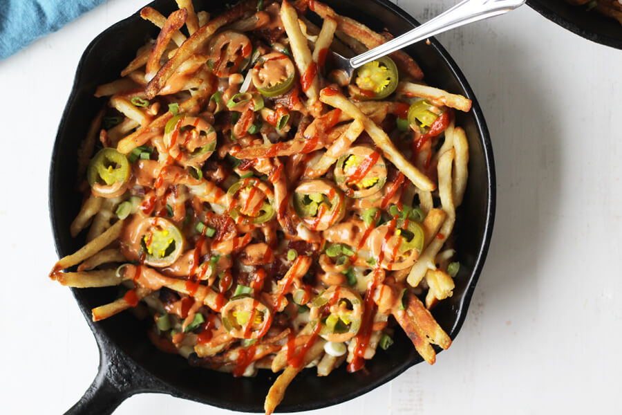 "Topped with a spicy homemade ""diablo"" sauce, pepper jack cheese, and jalapenos, these loaded French fries are craveable."