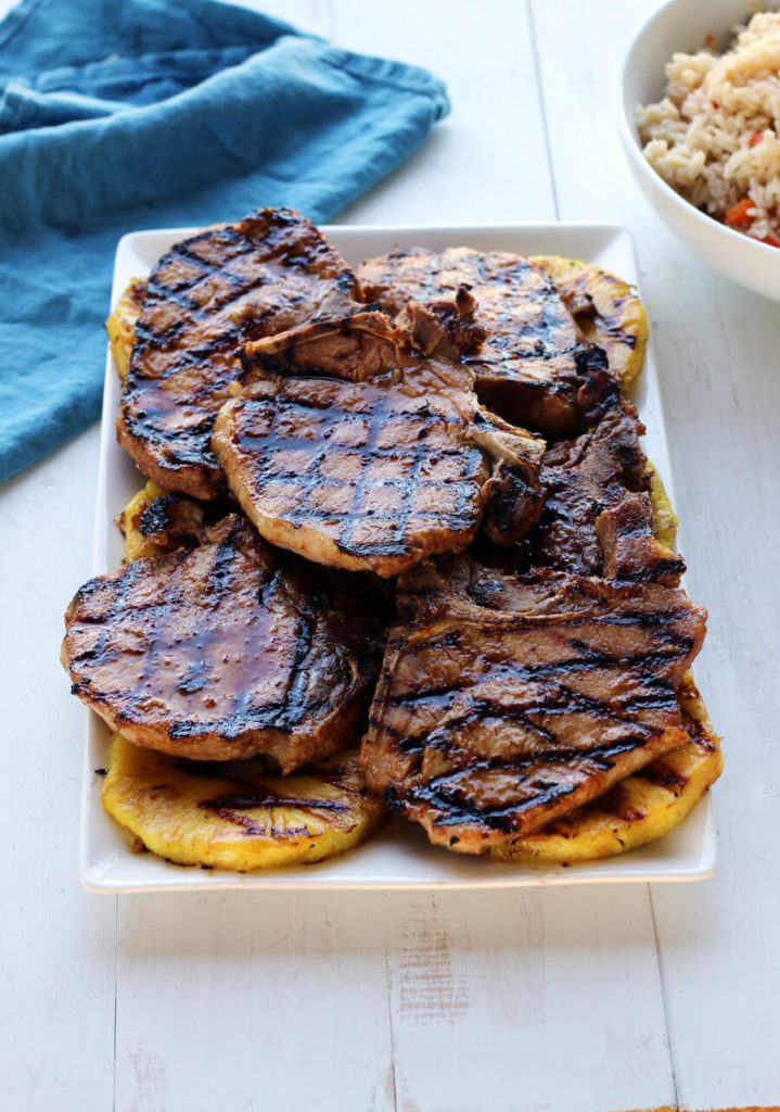 Delicious, tender pork chops are marinated in a fresh homemade pineapple-soy marinade then grilled to perfection. Serve with grilled pineapple because YUM!