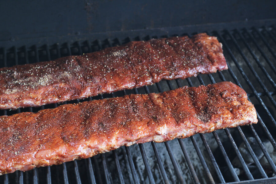 BBQ Ribs roasting over indirect charcoal grill