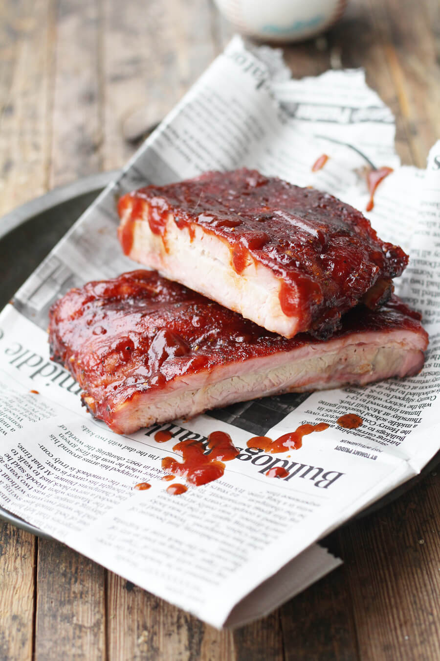 St Louis Style BBQ RibsThis recipe for St. Louis Style BBQ Ribs is lip-smacking good. Slow roasted with charcoal, this rib recipe features a homemade spice rub and sauce.