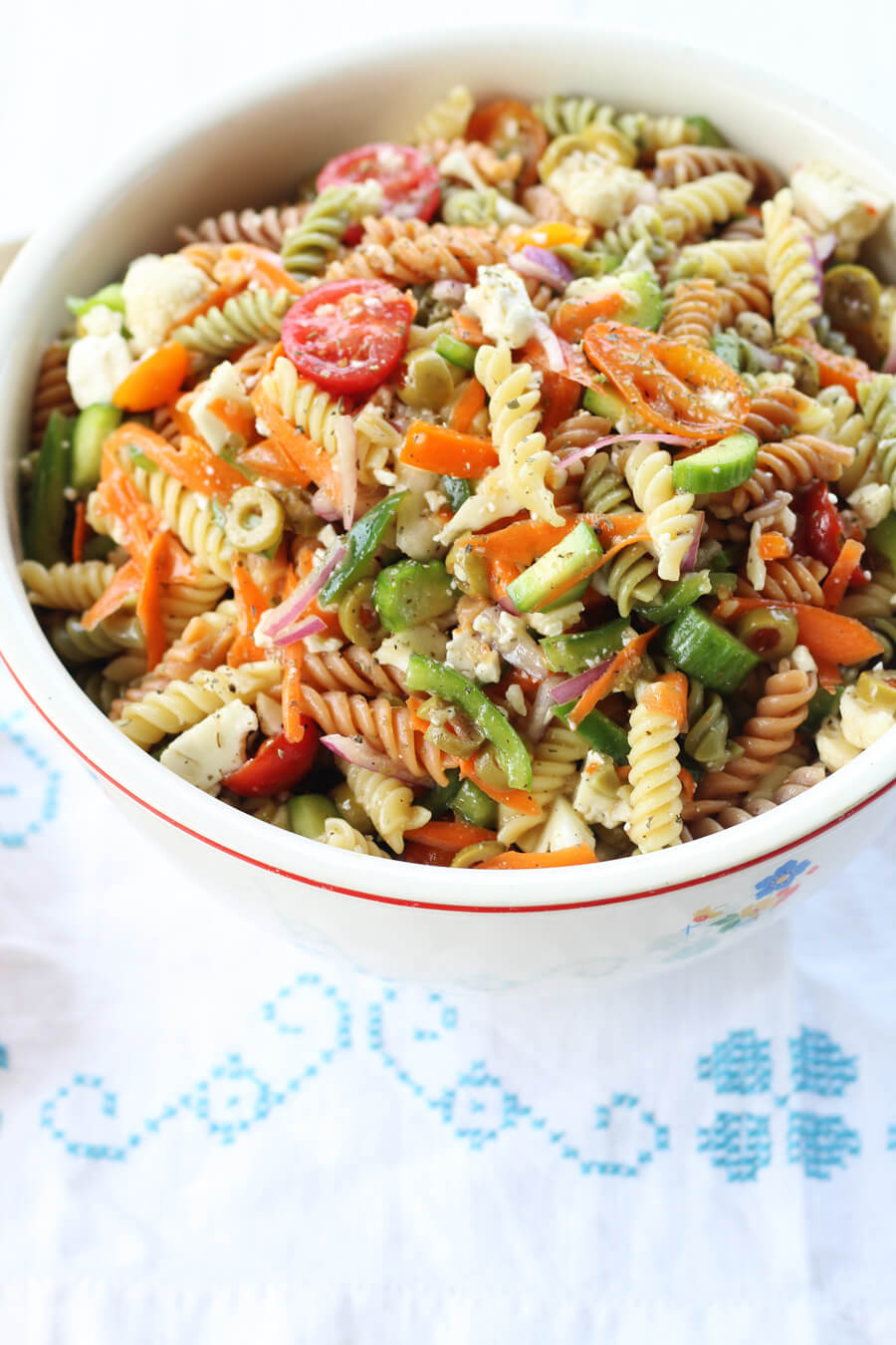 Zesty Italian Pasta Salad | Buy This Cook ThatGet our delicious go-to recipe for Italian Pasta Salad. With colorful, healthy vegetables, a tangy dressing, and tri-color pasta, this side dish always pleases.Easy to make ahead, too.#Italianpastasalad #pastasalad