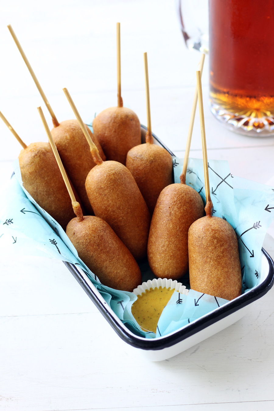 Indulge your summer food cravings with these delicious Beer Battered Bratwurst Corn Dogs!This recipe features savory bratwurst sausages dipped in a golden, homemade beer batter then deep-fried to perfection.#corndogs #bratwurst