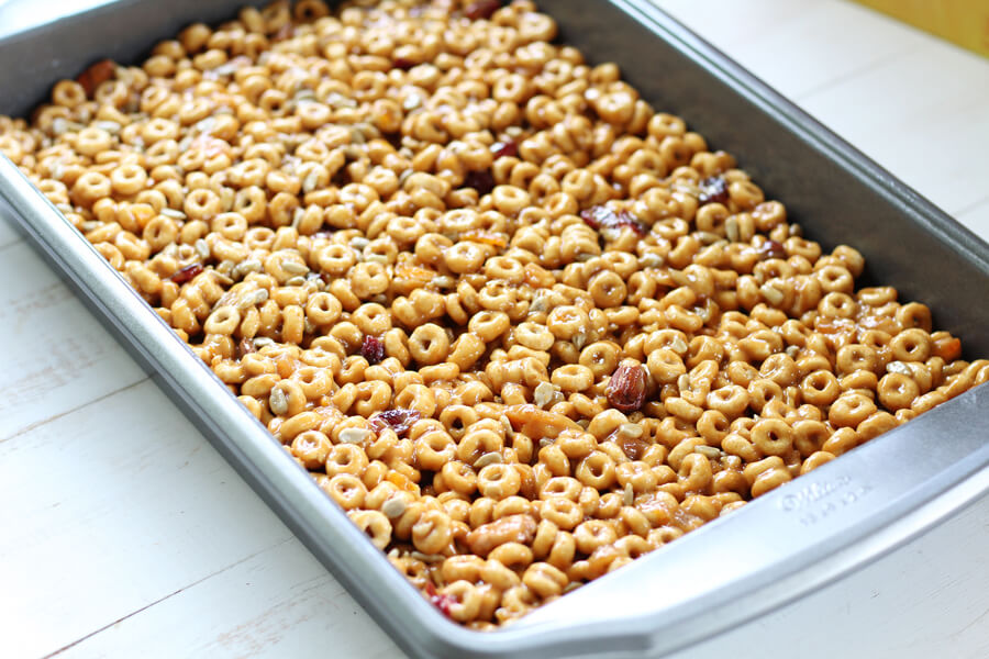 A 9x13 baking pan filled with peanut butter and honey covered cereal