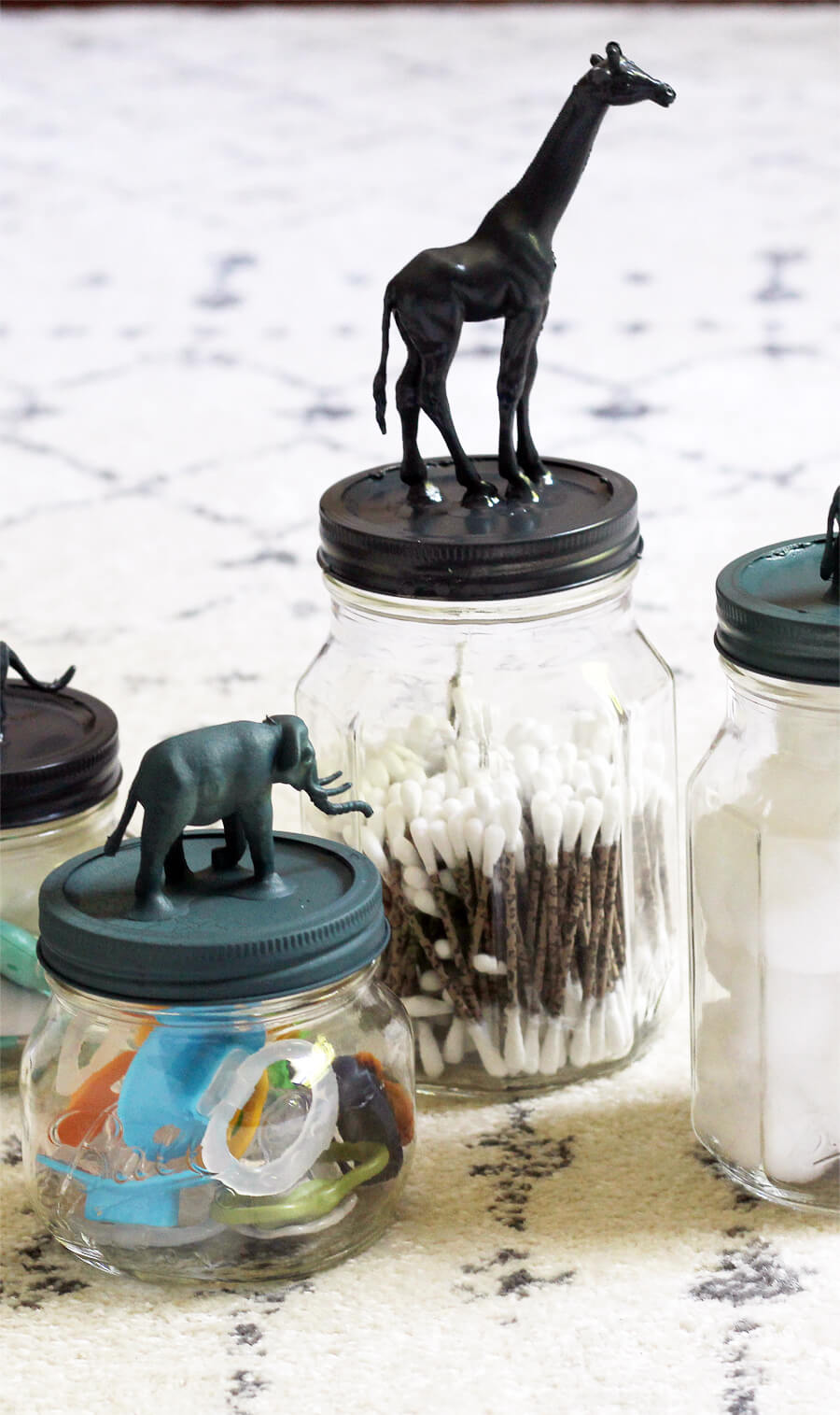 Need a cute and affordable way to add a little pizzazz to your baby's nursery on a budget?? These Safari Animal Mason jars are cute and functional.#masonjars #safarianimals #babynurseryideas